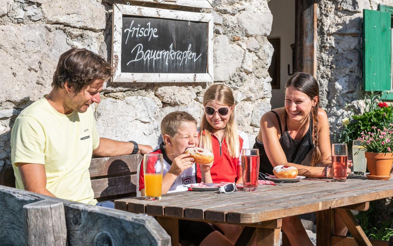 Family taking a break in an alpine hut