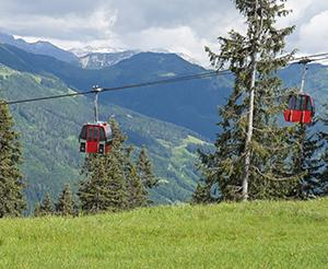 The red gondolas of the Kleinarl cable cars in summer