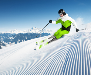 Skiers on freshly groomed slopes