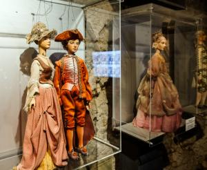 colourful marionettes side by side