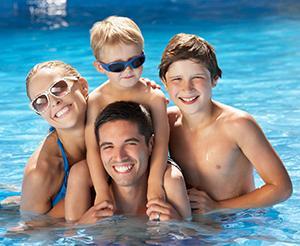 Happy family bathing