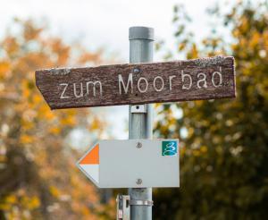 Signpost to the moor bath Symbolic image