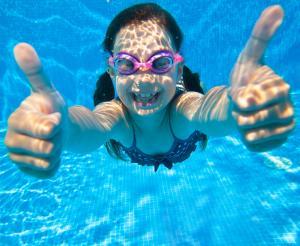 Girls diving in the indoor pool