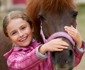 Child with pony